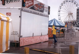 Signs and siding gets power washed at the New England Fair.