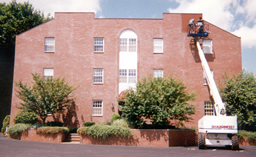 Power washing improves the appearance of this brick building.