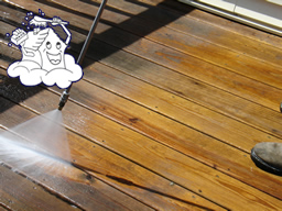 A weathered deck floor - before and after power washing.